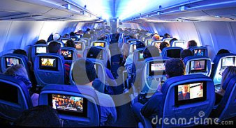 airplane-passengers-seats-tv-screens 2-flying-coach-commercial-flight-built-49800624 (1)
